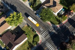 School bus picking up children. Overhead view of a school bus picking up children in a neighborhood Stock Images