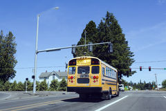 School Bus at Railroad Crossing. Rear view of school bus stopped at rural railroad crossing Royalty Free Stock Photos