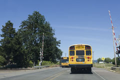 School bus at Railroad Crossing Stock Photography