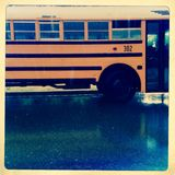 School bus in rain Stock Photography