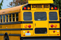 School Bus. Read and partial side of shiny yellow school bus stock photo