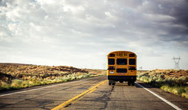 School bus on the road. Yellow school bus on the road, USA royalty free stock images