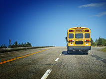 School bus on the road from behind Royalty Free Stock Images