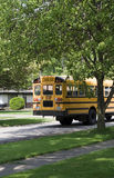 School Bus in route. Public School Bus in suburban neighborhood royalty free stock image
