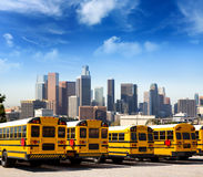 School bus in a row at LA skyline photo mount Stock Images