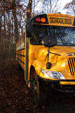School Bus in the Shade. A left front view of a school bus parked in the shade Stock Images