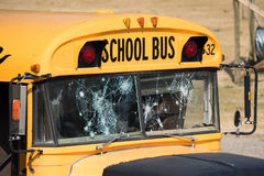 School Bus Shot Up With Bullet Holes After Shooting. A shot up school bus, which was part of a training ground for police dogs royalty free stock images