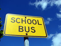 School Bus Sign. Photograph of local school bus sign with blue sky and cloud background Royalty Free Stock Image