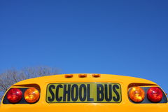 School bus sign. School bus and blue sky Royalty Free Stock Photo