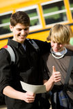 School Bus: Smart Teen Gets Good Report Card Royalty Free Stock Image