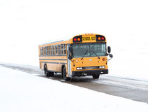 School bus in snow. School bus driving in the winter on rural road Stock Photography