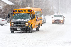 School bus in snowstorm. School bus on the street during a winter storm Royalty Free Stock Photos
