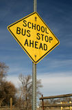 School Bus Stop Ahead. A rather grungy and old and weathered School Bus Stop sign in a rural setting Royalty Free Stock Image