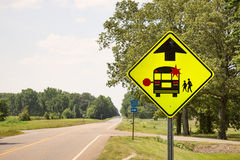 School Bus Stop. Roadside sign to warn drivers of a possible stopped school bus Stock Photography