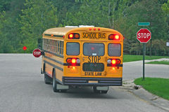 School Bus at Stop Sign Royalty Free Stock Photo