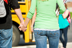 School Bus: Teen Students Hold Hands Royalty Free Stock Photos