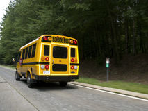 School bus traveling on road Royalty Free Stock Photo