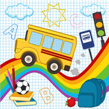 School bus travels over the rainbow Stock Photo