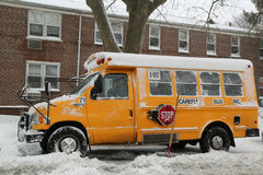 School bus under snow in Brooklyn, NY after massive Winter Storm Niko strikes Northeast. Stock Photos