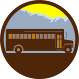 School Bus Vintage Mountains Circle Retro. Illlustration of a vintage school bus viewed from the side with mountains in the background set inside circle done in Royalty Free Stock Photos