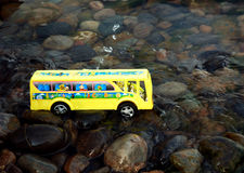 School bus in water Stock Photo