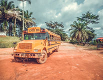 School bus. West Africa, Liberia. School bus on a background of dusty dirt roads in Liberia. Public transport for children in Africa Royalty Free Stock Photography