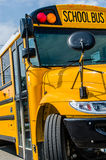 School Bus. Yellow big School bus ready to pick up and  transport kids / children / school age people at the bus stop Royalty Free Stock Image