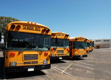 School Buses. Lined Up and Parked For The Weekend Stock Image
