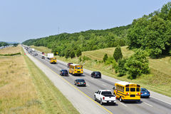 School Buses With Other Traffic Royalty Free Stock Images