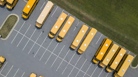 School Busses Parked At School Stock Photography