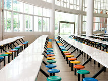 School cafeteria. Clean school cafeteria with many empty seats and tables Stock Photos
