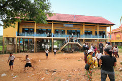 School at Cambodia. Non-governmental organization volunteers visiting school at Kompong Phluk, Cambodia Stock Image