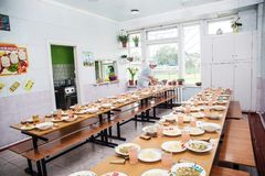 School canteen, cooking for lunch for students. royalty free stock images