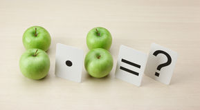 School card and apple with math. Problems royalty free stock images