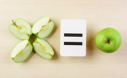 School card and apple with math. Problems stock photography