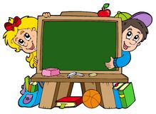 School chalkboard with two kids Stock Photos