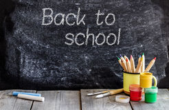 School chalkboard and wooden table stock photos