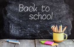 School chalkboard and wooden table royalty free stock image