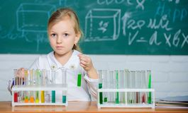 School chemical experiment. School education. Interesting approach to learn. Future scientist. Explore and investigate. School lesson. Girl cute school pupil royalty free stock photos