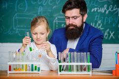 School chemistry experiment. Explaining chemistry to kid. How to interest children study. Fascinating chemistry lesson. Man bearded teacher and pupil with test royalty free stock images