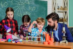 School chemistry laboratory. back to school. Science and education. chemistry lab. happy children teacher. Laboratory stock photo