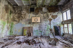 School in Chernobyl Zone. School gym in abandoned military town called Chernobyl-2 in Chernobyl Exclusion Zone, Ukraine royalty free stock photos