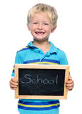 School child. Preschool child holds a blackboard with the word school stock images