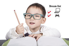 School child boy in glasses studying book Royalty Free Stock Photos