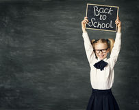 School Child Girl hold Blackboard, Back to School, Kid Black Board. School Child Girl hold Blackboard, Back to School, Happy Kid in Classroom over Black Board Royalty Free Stock Image