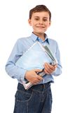 School child holding books and notebooks Stock Images