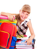 School child holding stack of books. Stock Image