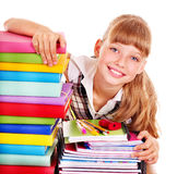 School child holding stack of books. Royalty Free Stock Photos
