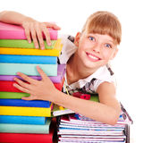 School child holding stack of books. Royalty Free Stock Images