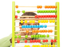 School child learning to count. School child boy with old colorful abacus learning to count stock photos